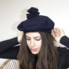 midnight blue beret with pom-pom